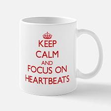 Keep Calm and focus on Heartbeats Mugs
