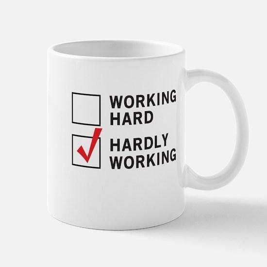 working hard hardly working Mugs
