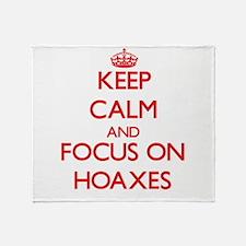 Unique Hoax Throw Blanket