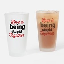 Love is being stupid Together Drinking Glass