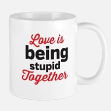 Love is being stupid Together Mugs