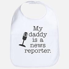 My daddy is a news reporter. Bib
