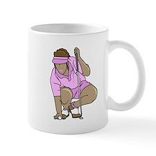 woman teeing ball Mugs
