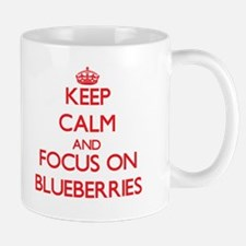 Keep Calm and focus on Blueberries Mugs