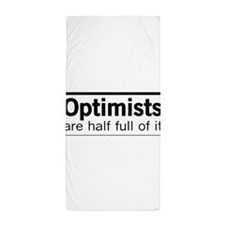 Optimists are half full of it Beach Towel