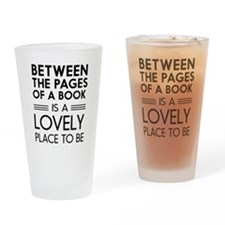 Between pages of book Drinking Glass