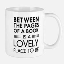 Between pages of book Mugs
