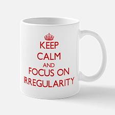 Keep Calm and focus on Irregularity Mugs
