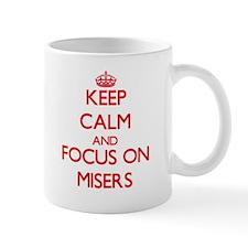 Keep Calm and focus on Misers Mugs