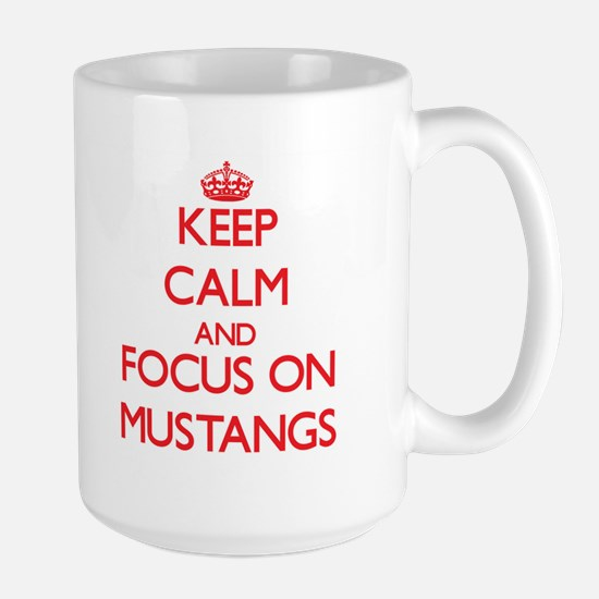 Keep Calm and focus on Mustangs Mugs