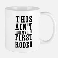 This Ain't My First Rodeo Mugs
