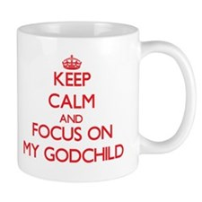 Keep Calm and focus on My Godchild Mugs