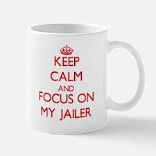 Keep Calm and focus on My Jailer Mugs