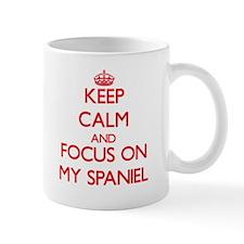 Keep Calm and focus on My Spaniel Mugs