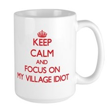 Keep Calm and focus on My Village Idiot Mugs