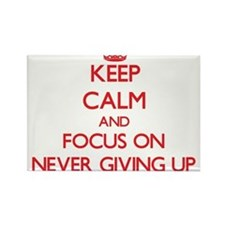 Keep Calm and focus on Never Giving Up Magnets