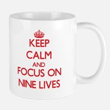 Keep Calm and focus on Nine Lives Mugs