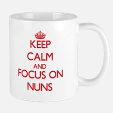 Keep Calm and focus on Nuns Mugs