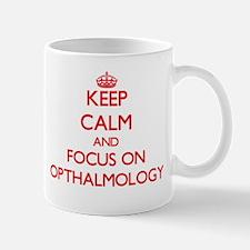 Keep Calm and focus on Opthalmology Mugs