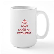 Keep Calm and focus on Optometry Mugs