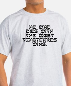 He who dies with the most Tchotchkes wins. T-Shirt