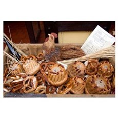 Bread and pretzels being sold at a bakery in the v Canvas Art