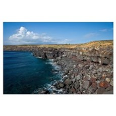 Hawaii. A swimmer perches on a rock on the Big Isl Poster