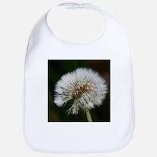 Cute Dandelion seeds blowing in the wind Bib