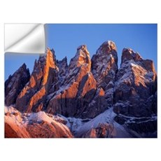 Late light rests on the craggy, snow-dusted peaks  Wall Decal