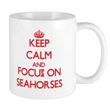 Keep Calm and focus on Seahorses Mugs