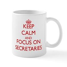 Keep Calm and focus on Secretaries Mugs