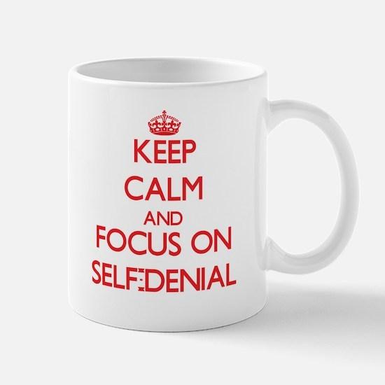 Keep Calm and focus on Self-Denial Mugs