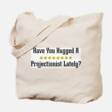 Hugged Projectionist Tote Bag