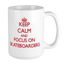 Keep Calm and focus on Skateboarders Mugs