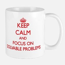 Keep Calm and focus on Solvable Problems Mugs