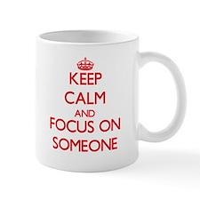 Keep Calm and focus on Someone Mugs