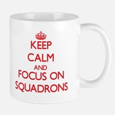Keep Calm and focus on Squadrons Mugs