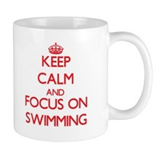 Keep Calm and focus on Swimming Mugs