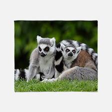two ring tailed lemurs Throw Blanket