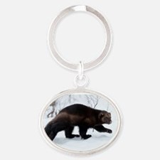 Wolverine in the snow Oval Keychain