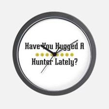 Hugged Hunter Wall Clock