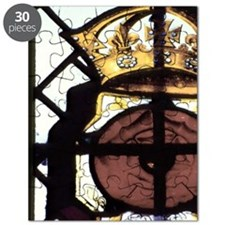 Stained glass window showing Rose of Lancas Puzzle
