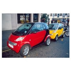 Smart cars on London street in England. These fuel Poster
