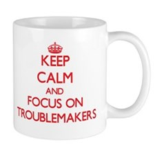 Keep Calm and focus on Troublemakers Mugs
