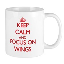 Keep Calm and focus on Wings Mugs