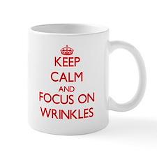 Keep Calm and focus on Wrinkles Mugs