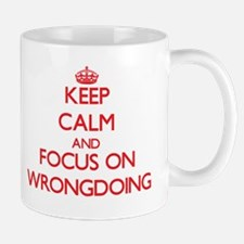 Keep Calm and focus on Wrongdoing Mugs
