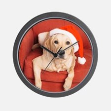 Dog with Christmas hat on armchair Wall Clock