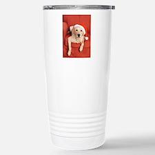 Dog with Christmas hat on armchair Travel Mug