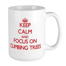 Keep Calm and focus on Climbing Trees Mugs